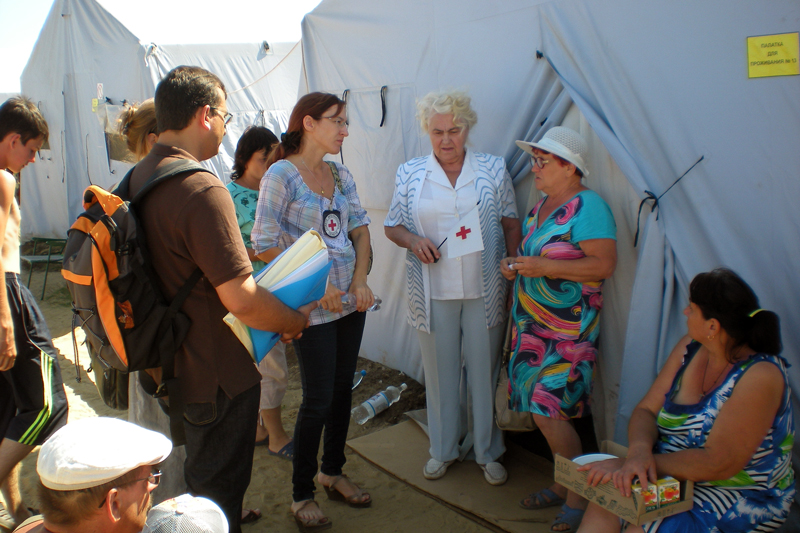Near Rostov, Russia, August 2014.  Personnel from the Rostov Branch of the Russian Red Cross and from the ICRC visit displaced Ukrainian families in a temporary camp.