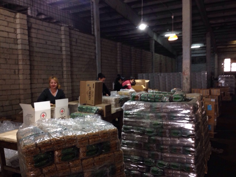 Crimea.  ICRC staff prepare food and other emergency supplies for distribution by local Red Cross branches.