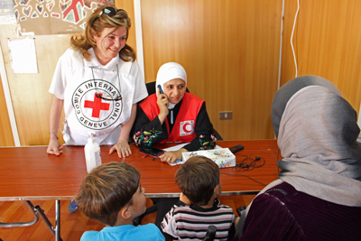 A Syrian family in Zaatari Camp prepares to contact their relatives by phone through a service offered jointly by the ICRC and the Jordanian Red Crescent.