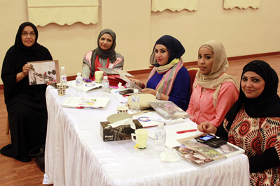 Volunteers from the Kuwait Red Crescent take part in a group exercise during Restoring Family Links training.
