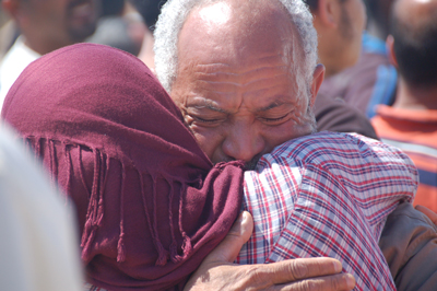 A man is reunited with his wife in Benghazi harbour on the arrival of an ICRC-chartered ship that had transferred people from Tripoli who were separated from their families by the 2011 conflict.